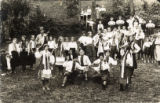 Group of youth in folk costumes