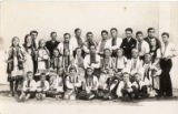 Andrii Kist with with a group of youth in folk costumes