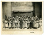 Women and men standing in front of Watkins Company Administration Building, Winona, Minnesota