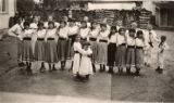 Image for Andrii Kist with with a group of youth in folk costumes